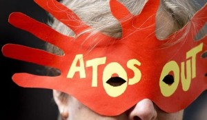 A protester demonstrates against IT company Atos's involvement in tests for incapacity benefits-1293530